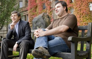 Russian-born scientists Andre Geim and Konstantin Novoselov pose outside the University of Manchester after it was announced that they had won a Nobel prize, in Manchester